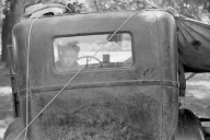 John Vachon - Migrant boy looking out of back window of auto. Berrien County, Michigan. July 1940.